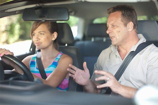 Father teaching teenage daughter driving Stock Photo - Premium Royalty-Free, Image code: 614-06623421