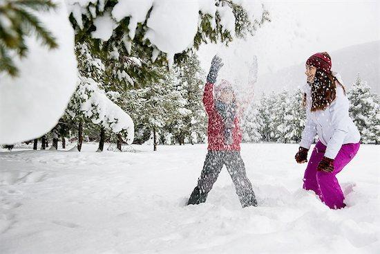 Children playing in snow Stock Photo - Premium Royalty-Free, Image code: 614-06719335
