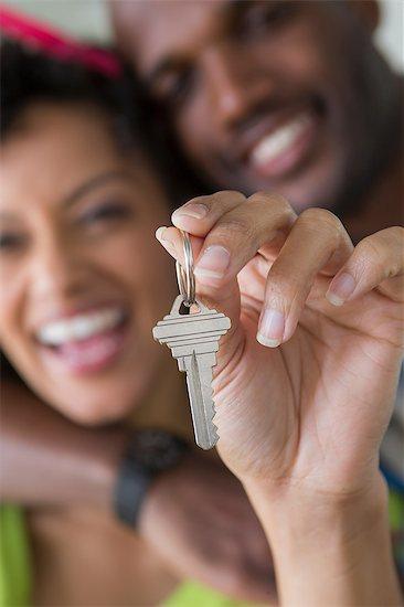 Mid adult couple holding house key Stock Photo - Premium Royalty-Free, Image code: 614-06897987