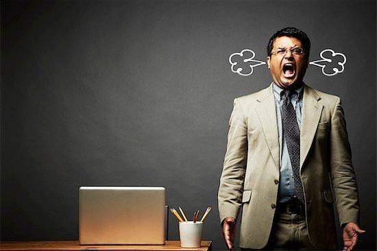 Man shouting and fuming Stock Photo - Premium Royalty-Free, Image code: 614-06898220