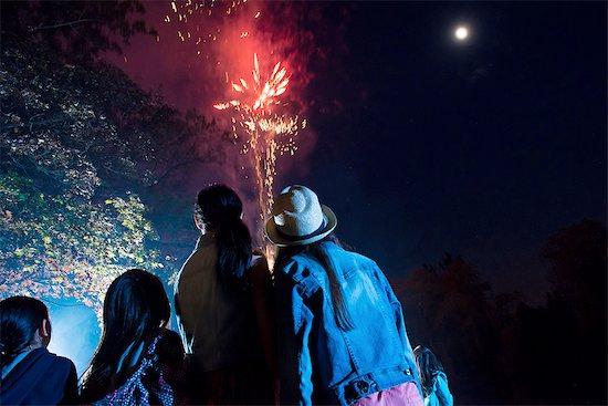 People watching fireworks display Stock Photo - Premium Royalty-Free, Image code: 614-06898440