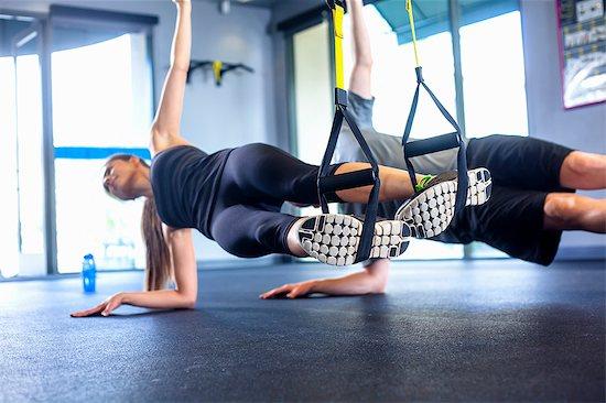 Couple doing side plank exercise Stock Photo - Premium Royalty-Free, Image code: 614-07487113