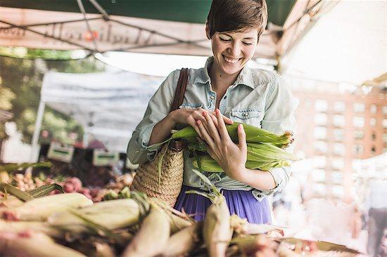 Woman shopping at vegetable market Stock Photo - Premium Royalty-Free, Image code: 614-07805784