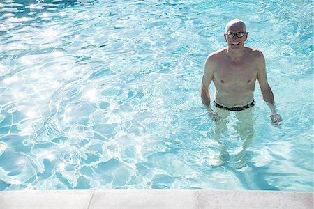 e467d19392bc9 Premium Royalty-Free. senior citizens pool - Senior man standing in outdoor  swimming pool