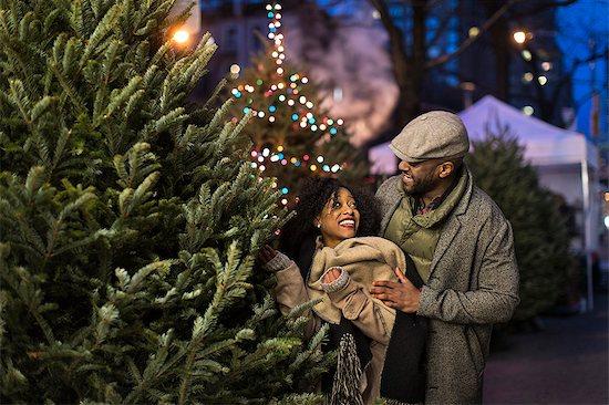 Couple choosing Christmas tree at night, New York, USA Stock Photo - Premium Royalty-Free, Image code: 614-08884744
