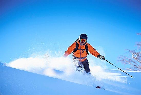 Man skiing down snow covered mountainside, Aspen, Colorado, USA Stock Photo - Premium Royalty-Free, Image code: 614-08983386