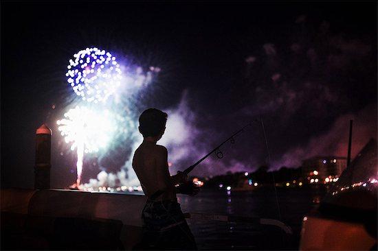 Boy watching fireworks, Destin, Florida Stock Photo - Premium Royalty-Free, Image code: 614-09056955