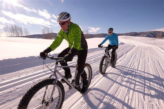 Couple snow biking in Colorado Stock Photo - Premium Royalty-Free, Image code: 618-08645563