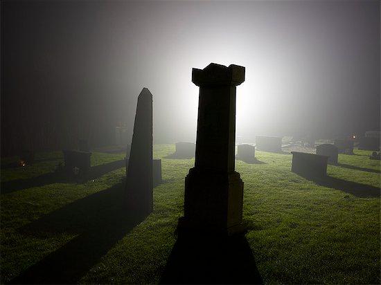 Cemetery at night Stock Photo - Premium Royalty-Free, Image code: 6102-07842795