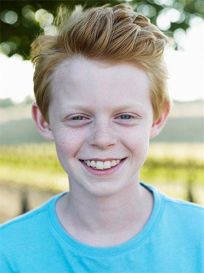Portrait of smiling boy Stock Photo - Premium Royalty-Free, Image code: 6102-08000892