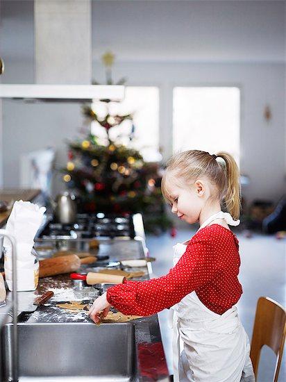 Girl preparing cookies Stock Photo - Premium Royalty-Free, Image code: 6102-08001141