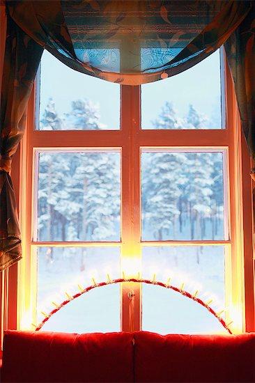Lights on windowsill Stock Photo - Premium Royalty-Free, Image code: 6102-08120112
