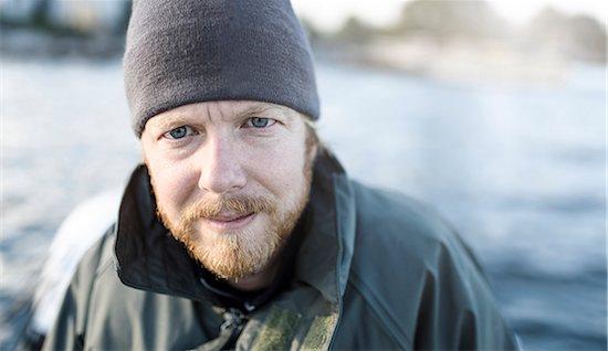 Portrait of man looking at camera Stock Photo - Premium Royalty-Free, Image code: 6102-08271124