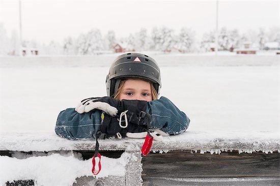 Portrait of girl wearing helmet Stock Photo - Premium Royalty-Free, Image code: 6102-08384209