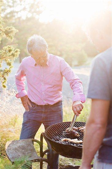 Men having barbecue Stock Photo - Premium Royalty-Free, Image code: 6102-08384395