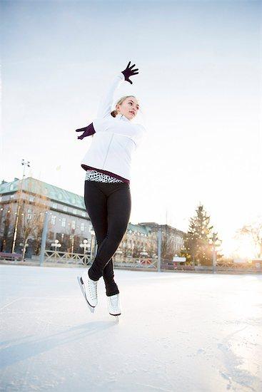 Woman figure skating Stock Photo - Premium Royalty-Free, Image code: 6102-08388100