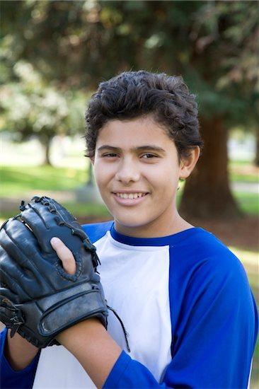 Thirteen year old hispanic boy with baseball glove Stock Photo - Premium Royalty-Free, Image code: 6106-05410469