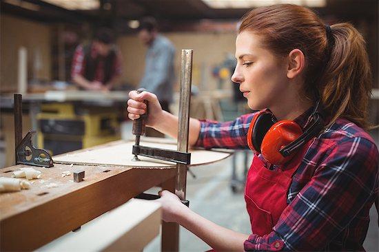 Female carpenter working in workshop Stock Photo - Premium Royalty-Free, Image code: 6109-08689937
