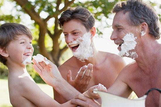 Playful multi-generation men applying shaving cream to faces Stock Photo - Premium Royalty-Free, Image code: 6113-06498565