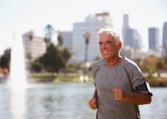 Older man jogging outdoors Stock Photo - Premium Royalty-Free, Image code: 6113-06499083
