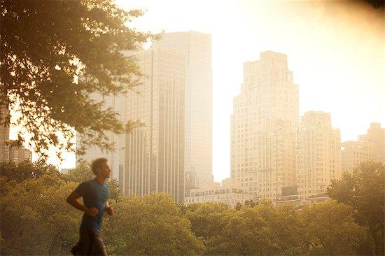 Man running in urban park Stock Photo - Premium Royalty-Free, Image code: 6113-06720344