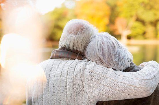 Older couple hugging in park Stock Photo - Premium Royalty-Free, Image code: 6113-06721289