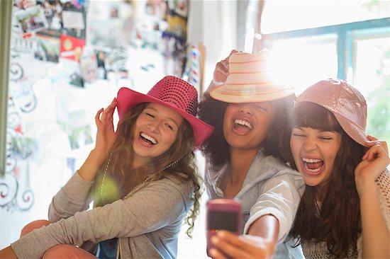 Women wearing hats in bedroom Stock Photo - Premium Royalty-Free, Image code: 6113-06908507