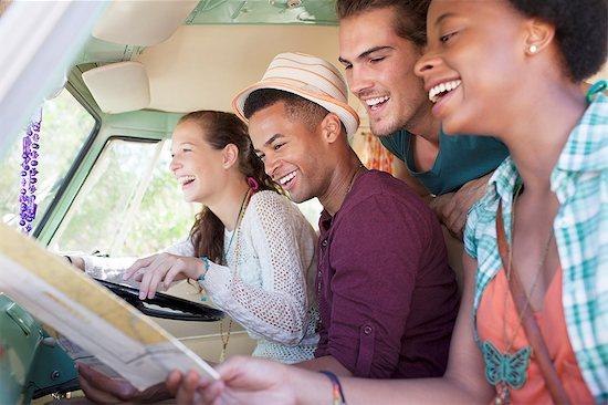 Smiling friends in van Stock Photo - Premium Royalty-Free, Image code: 6113-07147010