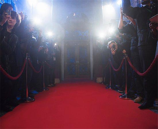 Paparazzi using flash photography along red carpet Stock Photo - Premium Royalty-Free, Image code: 6113-07160079