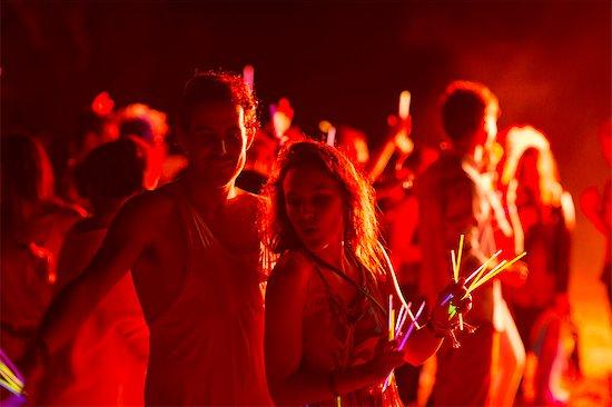 Couple dancing at music festival Stock Photo - Premium Royalty-Free, Image code: 6113-07564783