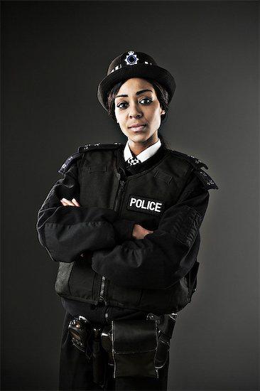 Portrait of serious policewoman Stock Photo - Premium Royalty-Free, Image code: 6113-07648730