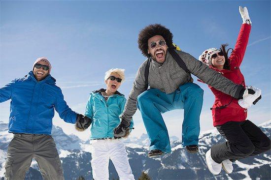 Portrait of exuberant friends in snow Stock Photo - Premium Royalty-Free, Image code: 6113-07906578