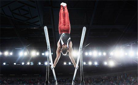 Gymnastics parallel bars skills Stock Photos - Page 1