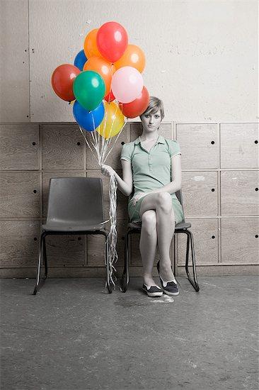 Teenage girl holding bunch of balloons Stock Photo - Premium Royalty-Free, Image code: 6114-06596855