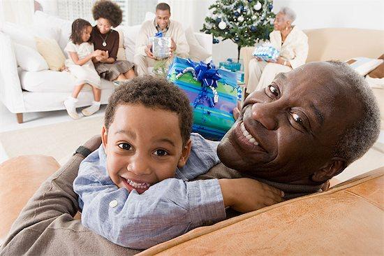 Family at christmas Stock Photo - Premium Royalty-Free, Image code: 6114-06605756