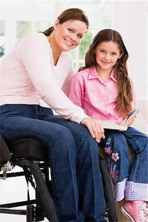 Photo kids girl wheelchair Stock Photos - Page 1 : Masterfile