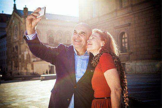 Senior couple taking a self portrait, Munich, Bavaria, Germany Stock Photo - Premium Royalty-Free, Image code: 6115-08100689