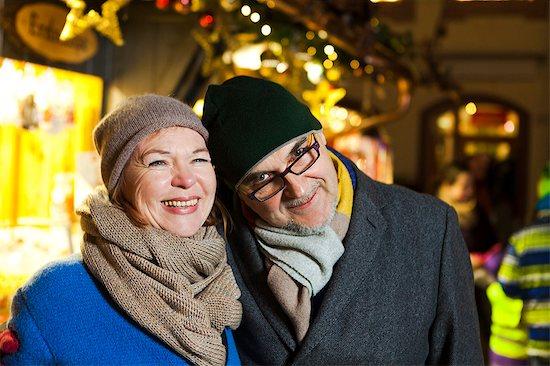 Senior couple at Christmas Market, Bad Toelz, Bavaria, Germany Stock Photo - Premium Royalty-Free, Image code: 6115-08105239