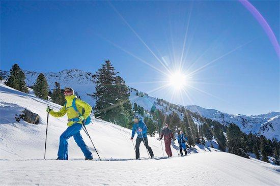 Skiers climbing snow mountain Stock Photo - Premium Royalty-Free, Image code: 6121-08972454