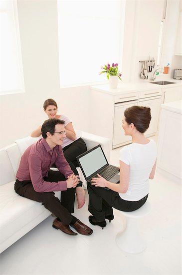 Business people talking in break room Stock Photo - Premium Royalty-Free, Image code: 6122-07706044