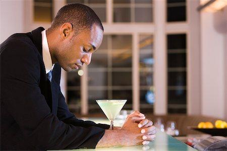 Black alcoholic man Stock Photos - Page 1 : Masterfile