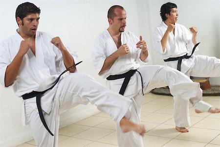Young men karate kicks Stock Photos - Page 1 : Masterfile