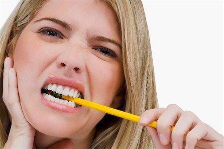 https www masterfile com search en women biting pencils