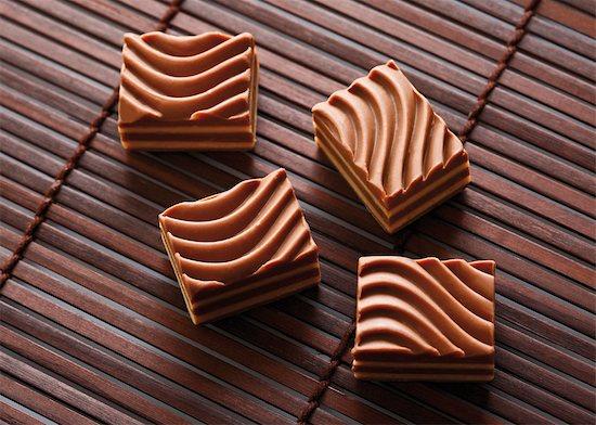 Chocolate candy Stock Photo - Premium Royalty-Free, Image code: 628-05818063