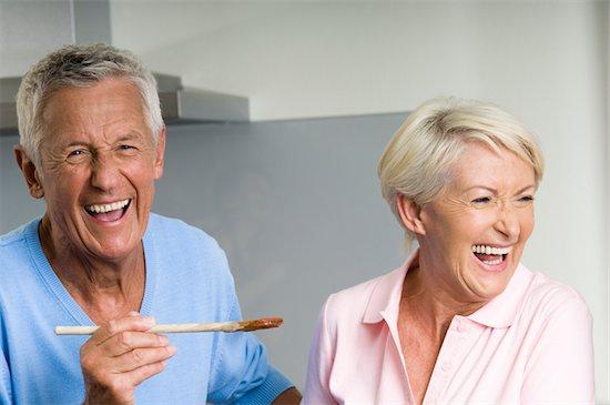Senior couple cooking together Stock Photo - Premium Royalty-Free, Image code: 628-02615401