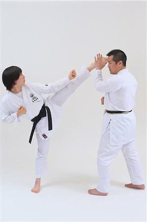 Female karate kicks Stock Photos - Page 1 : Masterfile