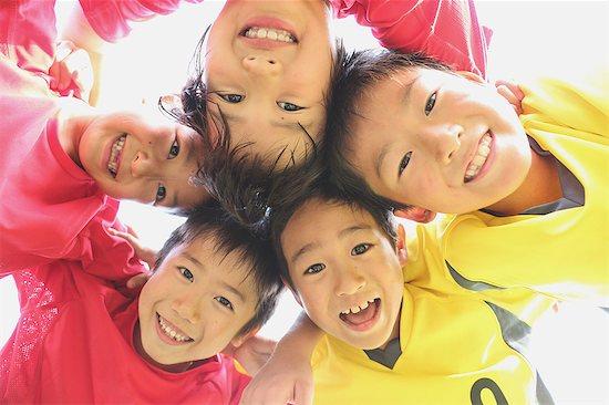 Japanese kids playing soccer Stock Photo - Premium Royalty-Free, Image code: 622-08893880