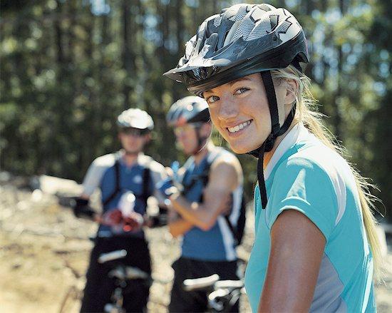 Three mountain bikers outdoors Stock Photo - Premium Royalty-Free, Image code: 635-01595494