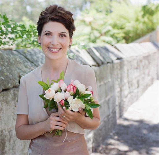 Mature bride holding bouquet Stock Photo - Premium Royalty-Free, Image code: 635-03515431