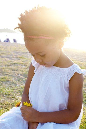 Little girl holding flowers, portrait Stock Photo - Premium Royalty-Free, Image code: 632-05759645